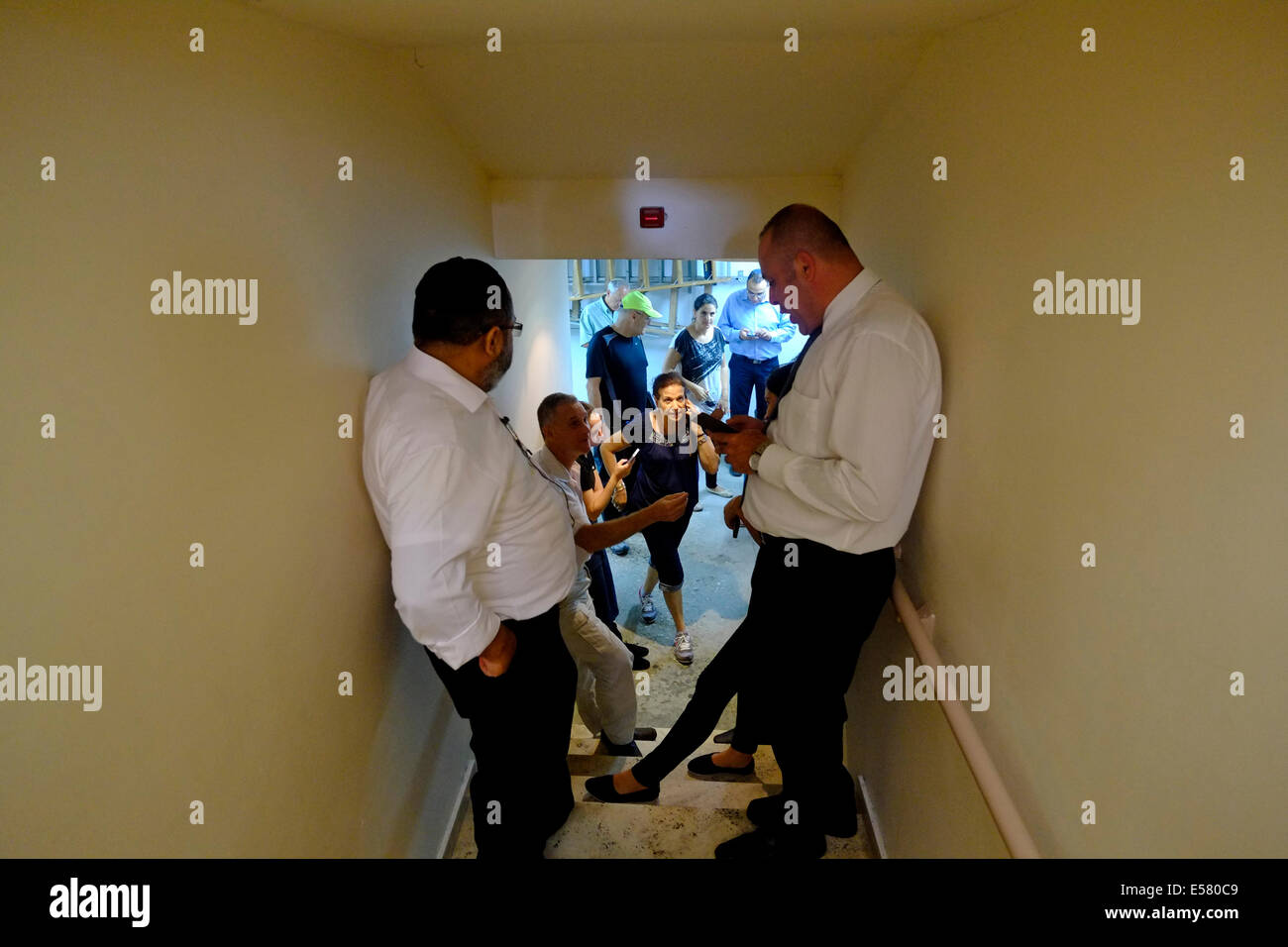 Israeli civilians inside a bomb shelter during rocket attack from Gaza strip in the coastal city of Ashkelon in - Stock Image