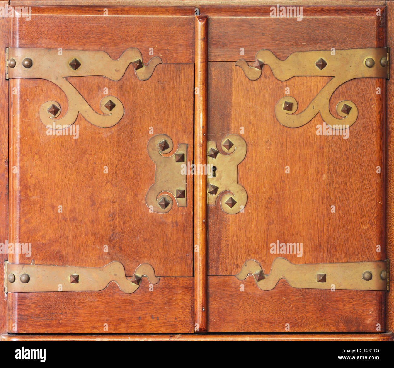 antique wood cabinet doors with brass hinges and lock - Antique Wood Cabinet Doors With Brass Hinges And Lock Stock Photo