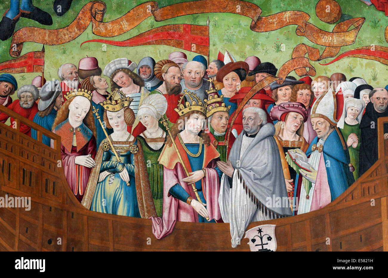 People of all classes of the middle ages gathered on board of a ship, painting on the Gothic St. Nicholas altar - Stock Image