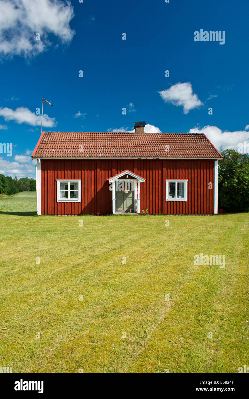 House painted Falu red, Smaland, Sweden - Stock Image
