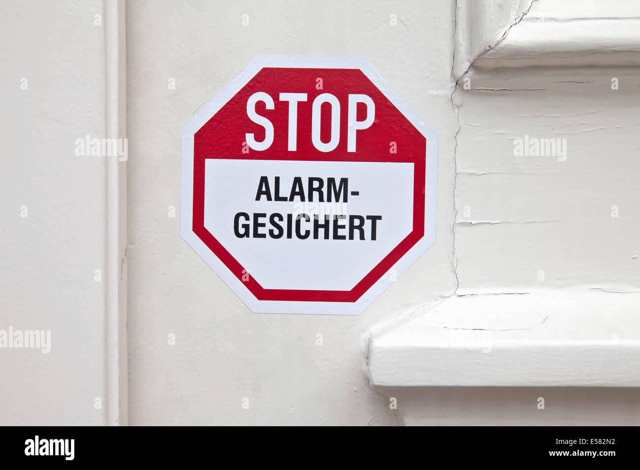 Stop, alarm system, sticker on the door, Germany - Stock Image