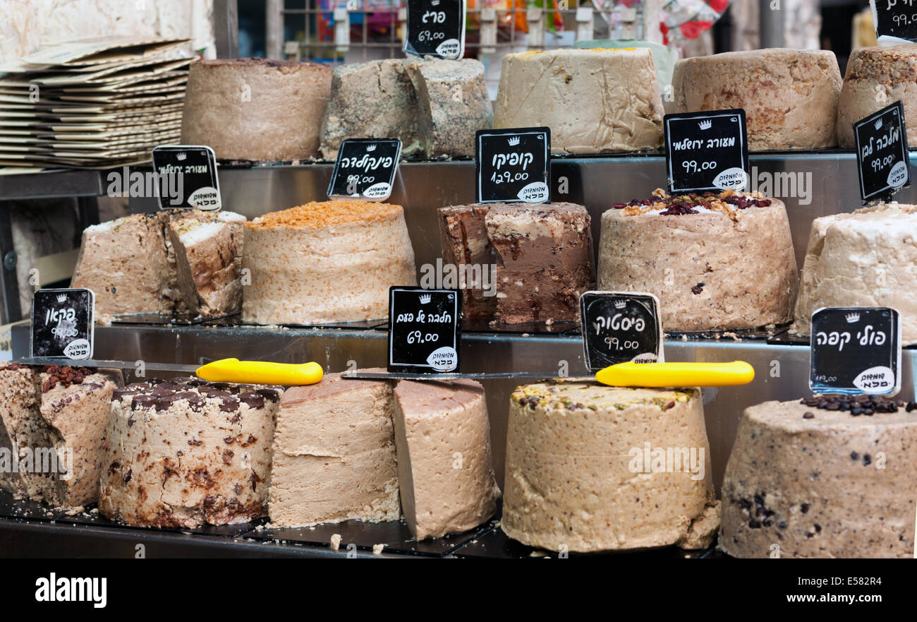 Halva, a sweet dense sesame confection for sale at Machane Yehuda market, Jerusalem, Israel - Stock Image