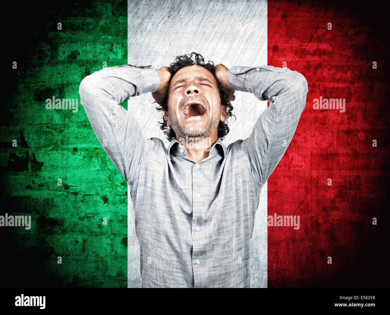 desperate man and italian flag - Stock Image