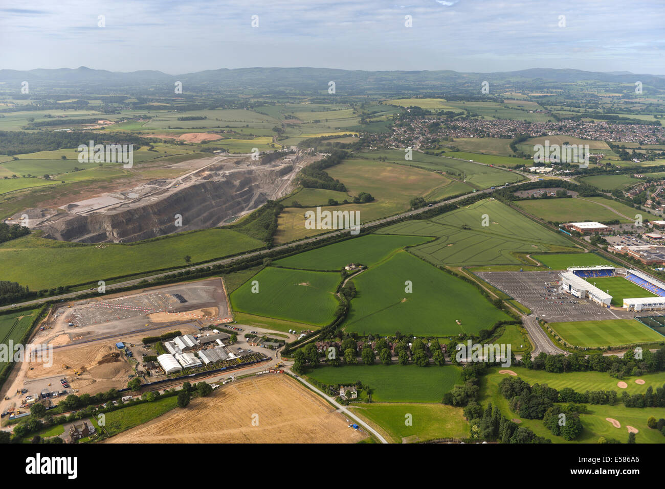 An aerial view looking south from Shrewsbury showing a quarry and distant Shropshire hills - Stock Image