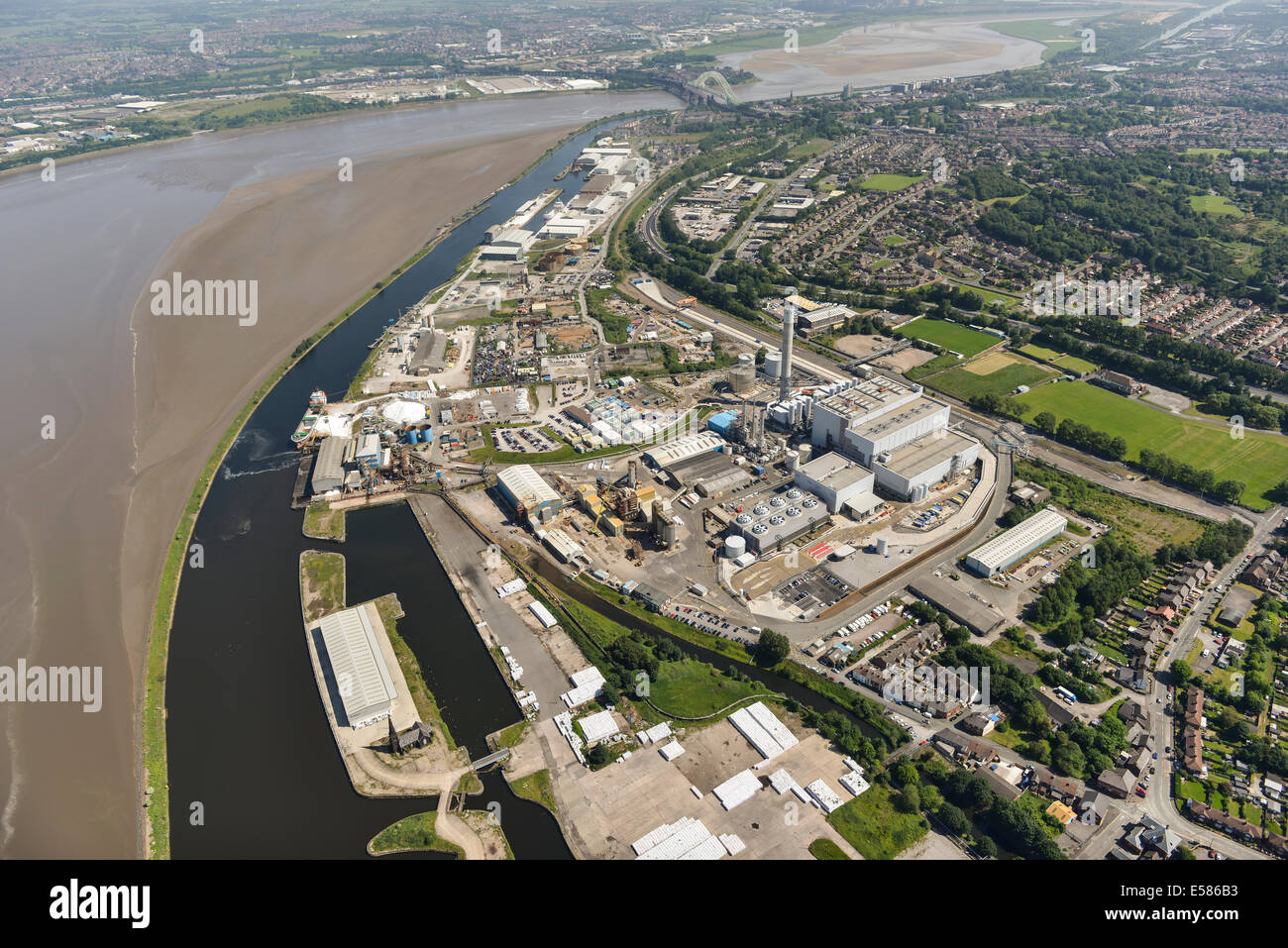 An aerial view showing Runcorn and Widnes, towns in Cheshire UK either side of the River Mersey. - Stock Image