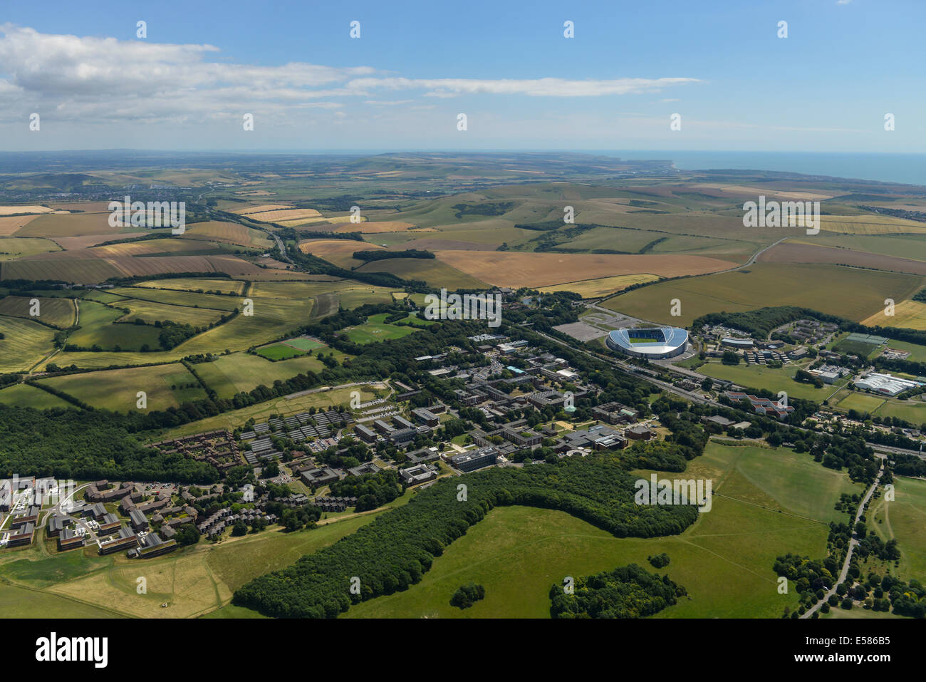 An aerial photograph showing the University of Sussex campus, the Falmer Stadium and the rolling South Downs in - Stock Image
