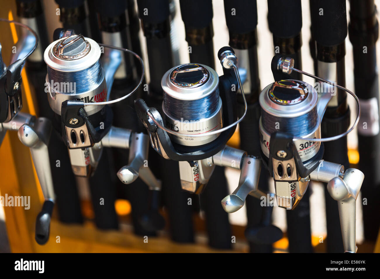 Fishing reels and rods for sale. Norfolk Broads. England UK Stock ...