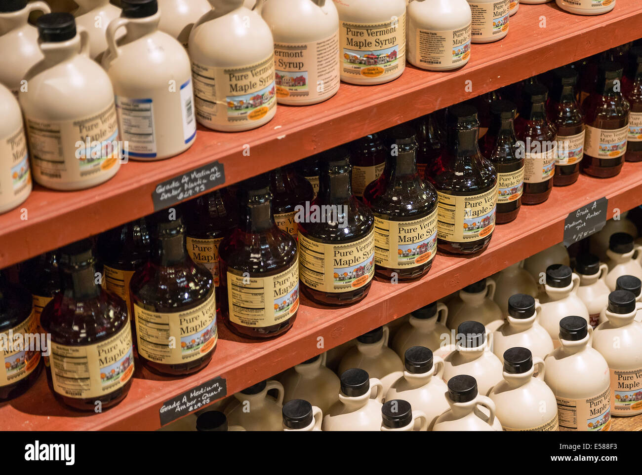 Jugs of maple syrup in a general store, Vermont, USA - Stock Image
