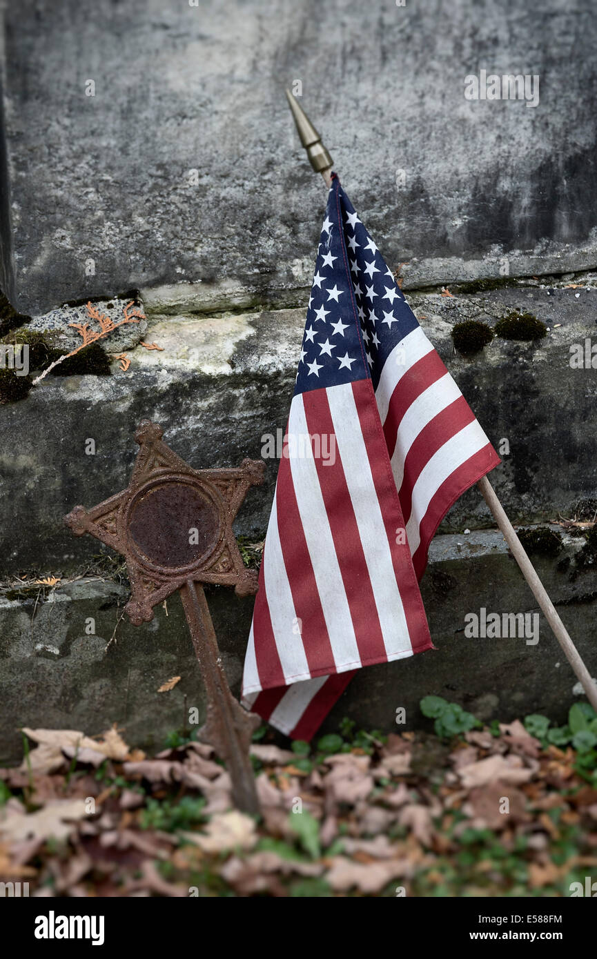 American flag next to veteran grave stone, Vermont, USA Stock Photo