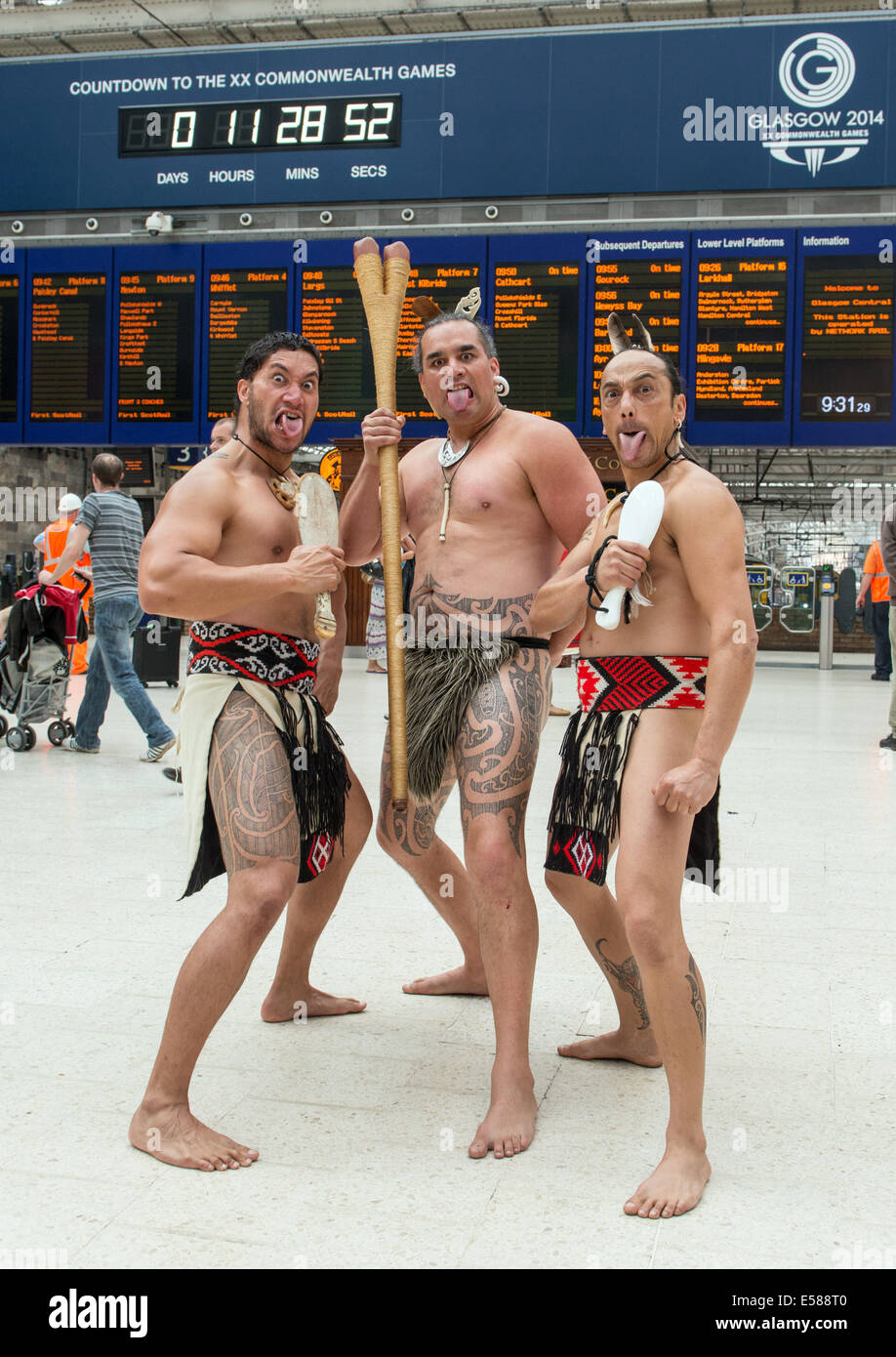 Glasgow, Scotland, UK. 23rd July, 2014. Māori warrior's greet the public at Central Station in Glasgow on the opening Stock Photo
