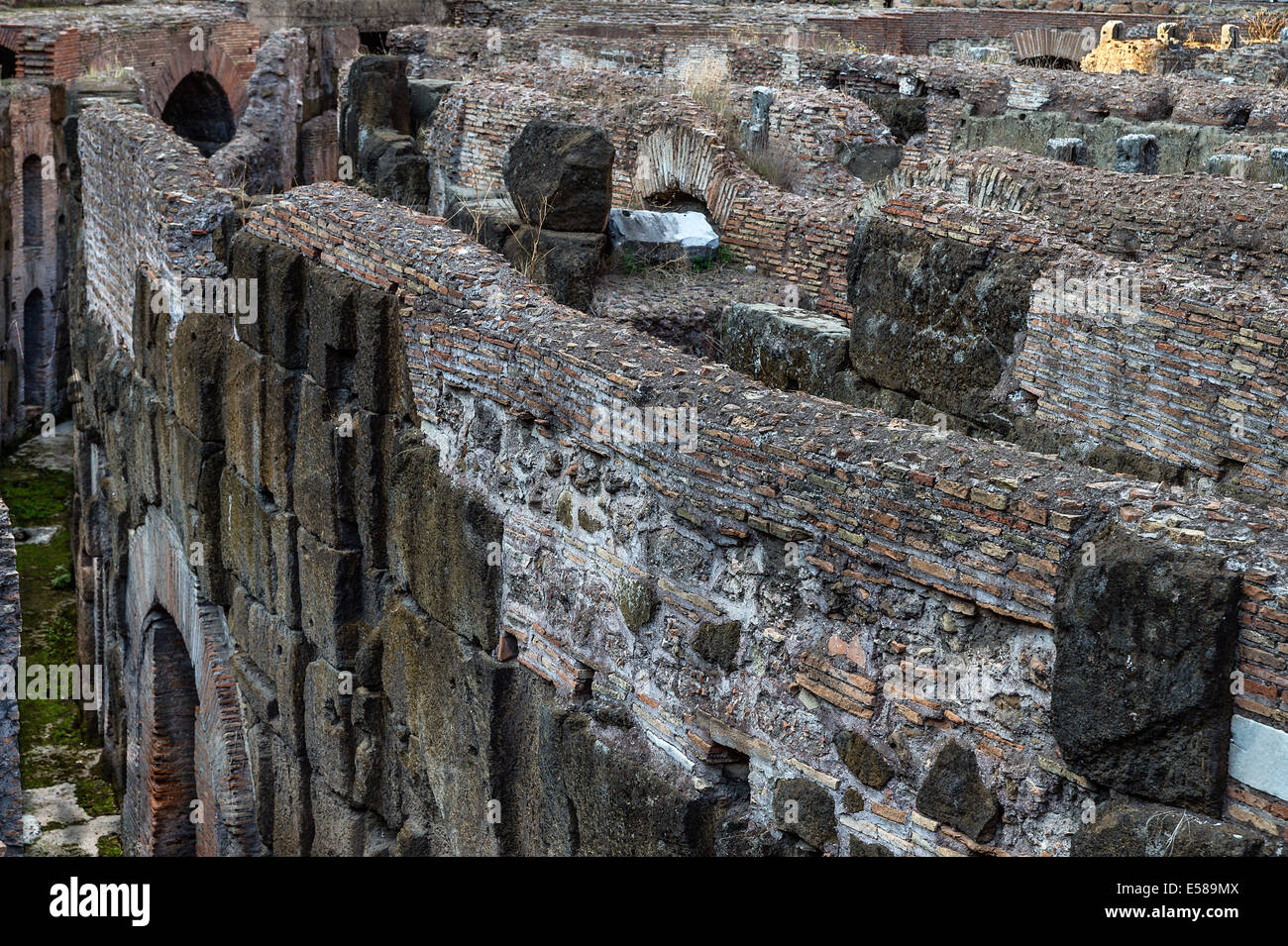 Underground interior ruins of The Colosseum, Rome, Italy - Stock Image
