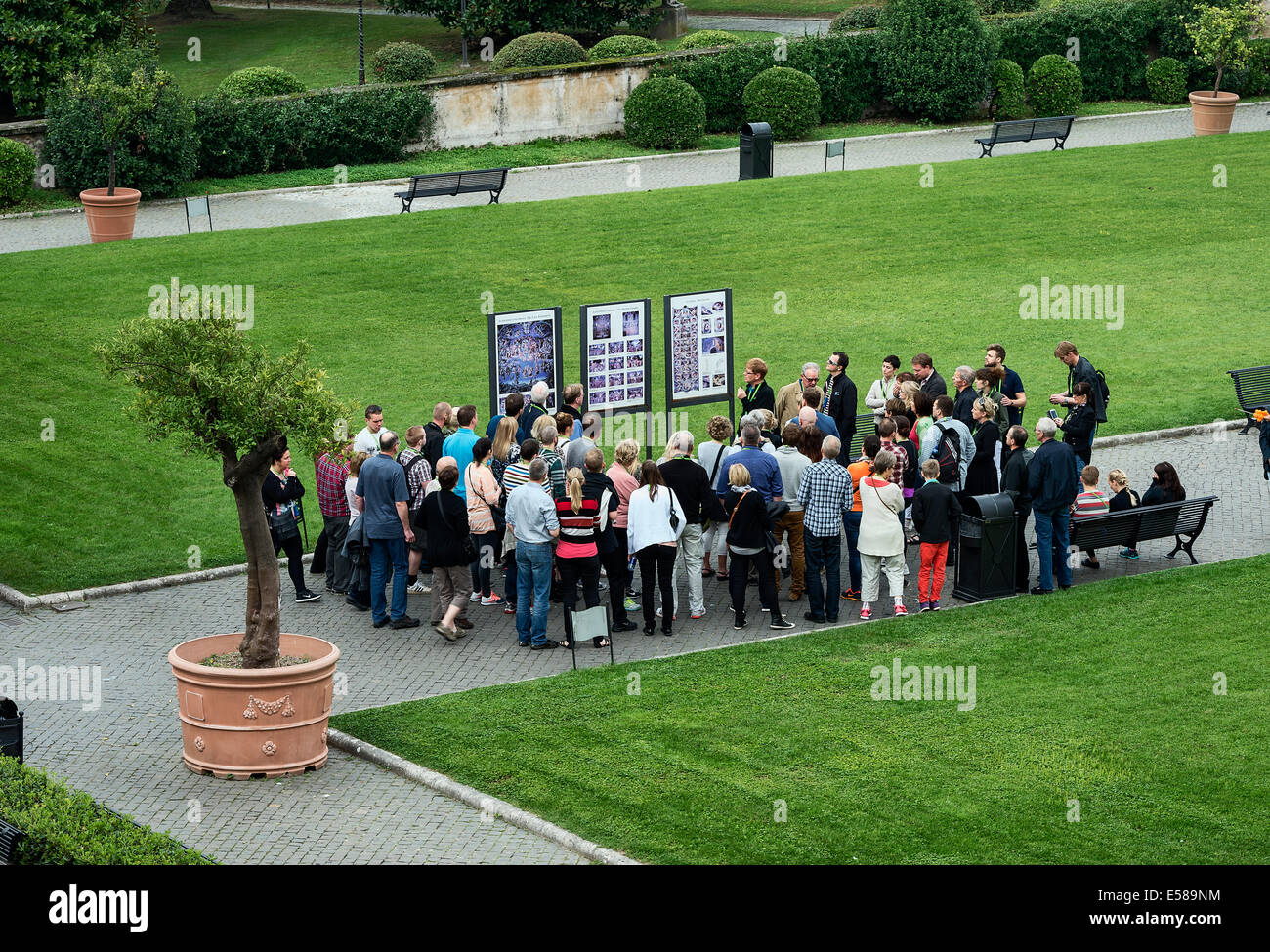 Group of tourists on guded tour of the Vatican grounds and Vatican Museums, Vatican City, Rome, Italy - Stock Image