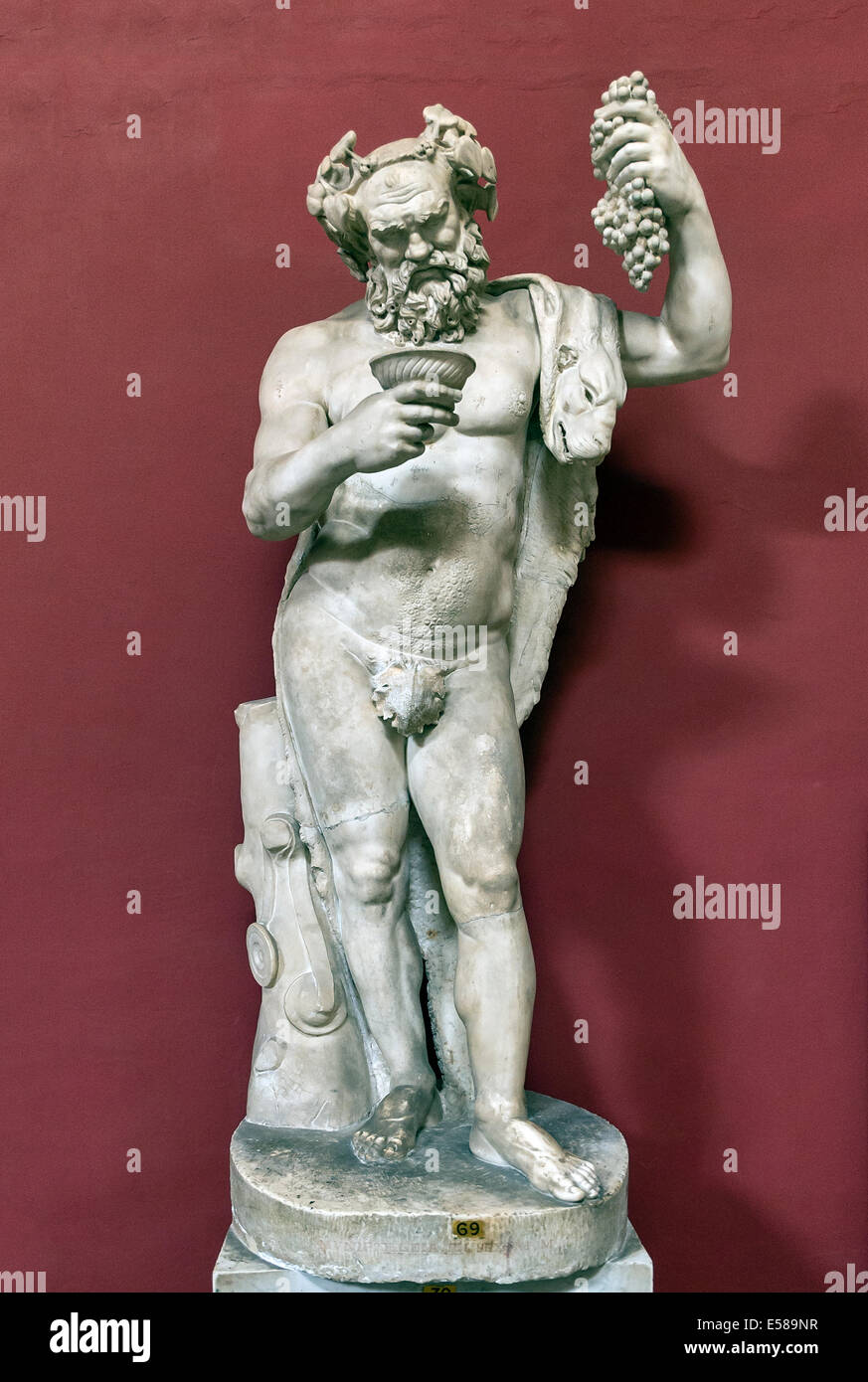 Marble statue of a drunken Silenus, Pio-Clementine Museum, Room of Muses, Vatican Museums, Rome, Italy - Stock Image