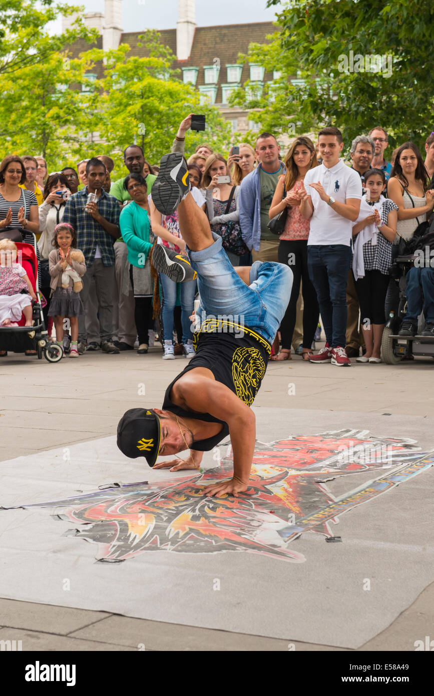 London , Southbank , amazing superb acrobatic modern street dancer dancers busk buskers crowds people tourists for - Stock Image