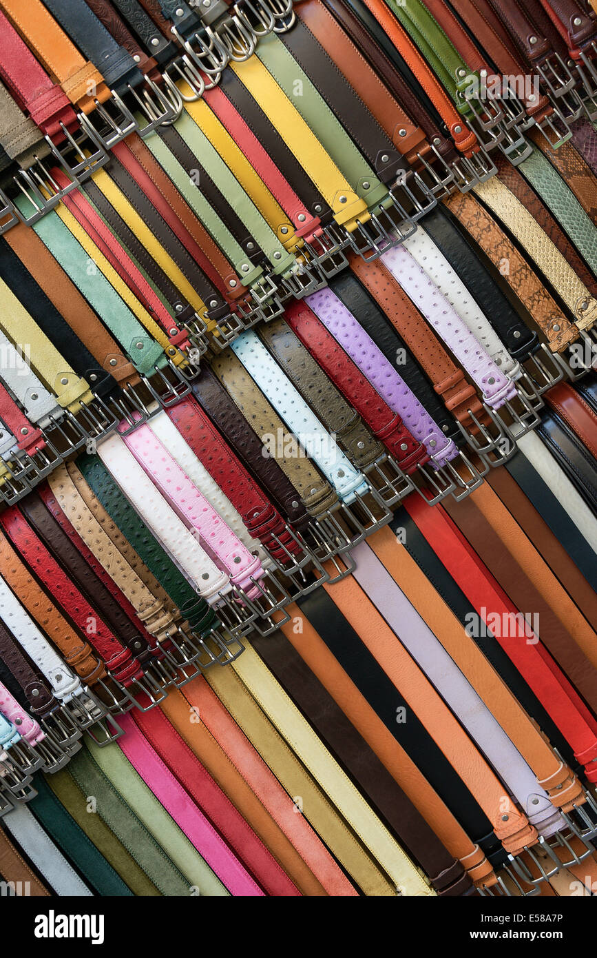 Italian leather belts for sale in a market stall, Mercato Nuovo, Florence, Italy - Stock Image