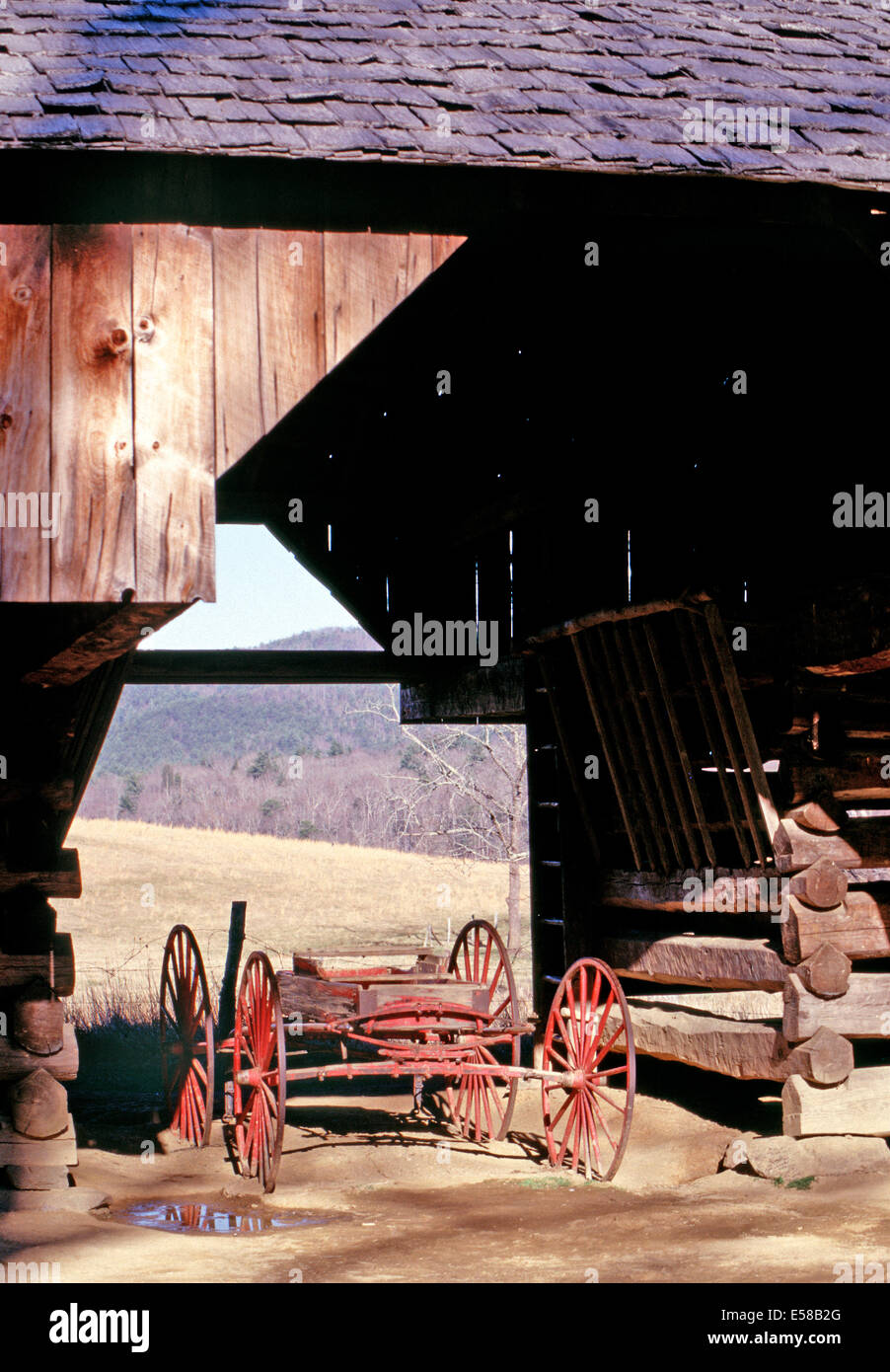 A carriage sits inside the double-cantilever barn,Cades Cove,Great Smoky Mountain National Park - Stock Image