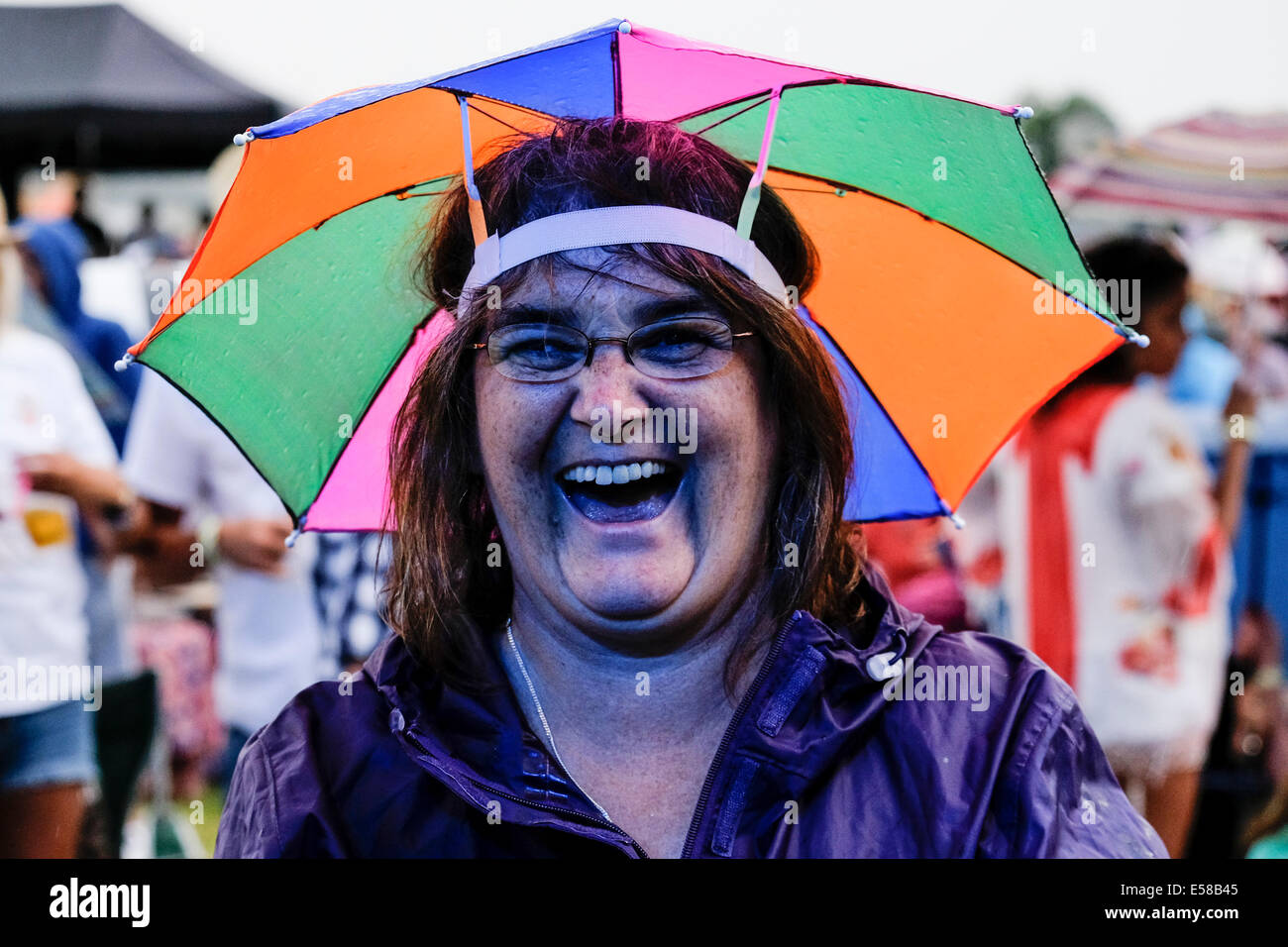 A festivalgoers enjoying herself at the Brentwood Festival. - Stock Image