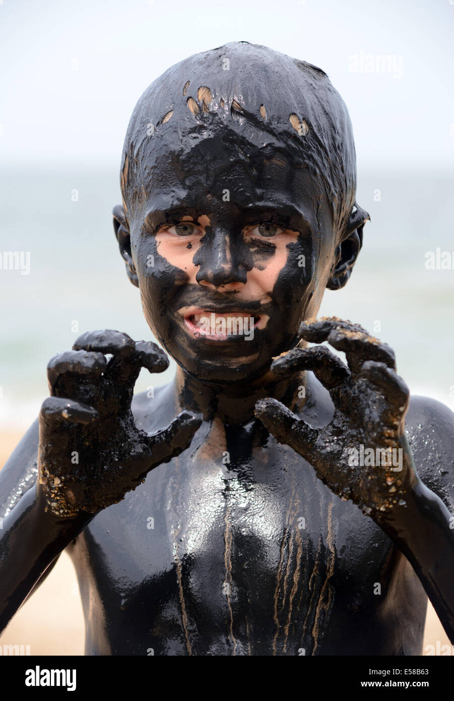 child in the mud - Stock Image
