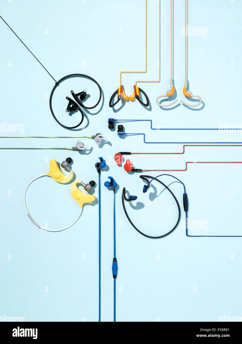 A creative still life of a variety of different styles of headphones - Stock Image