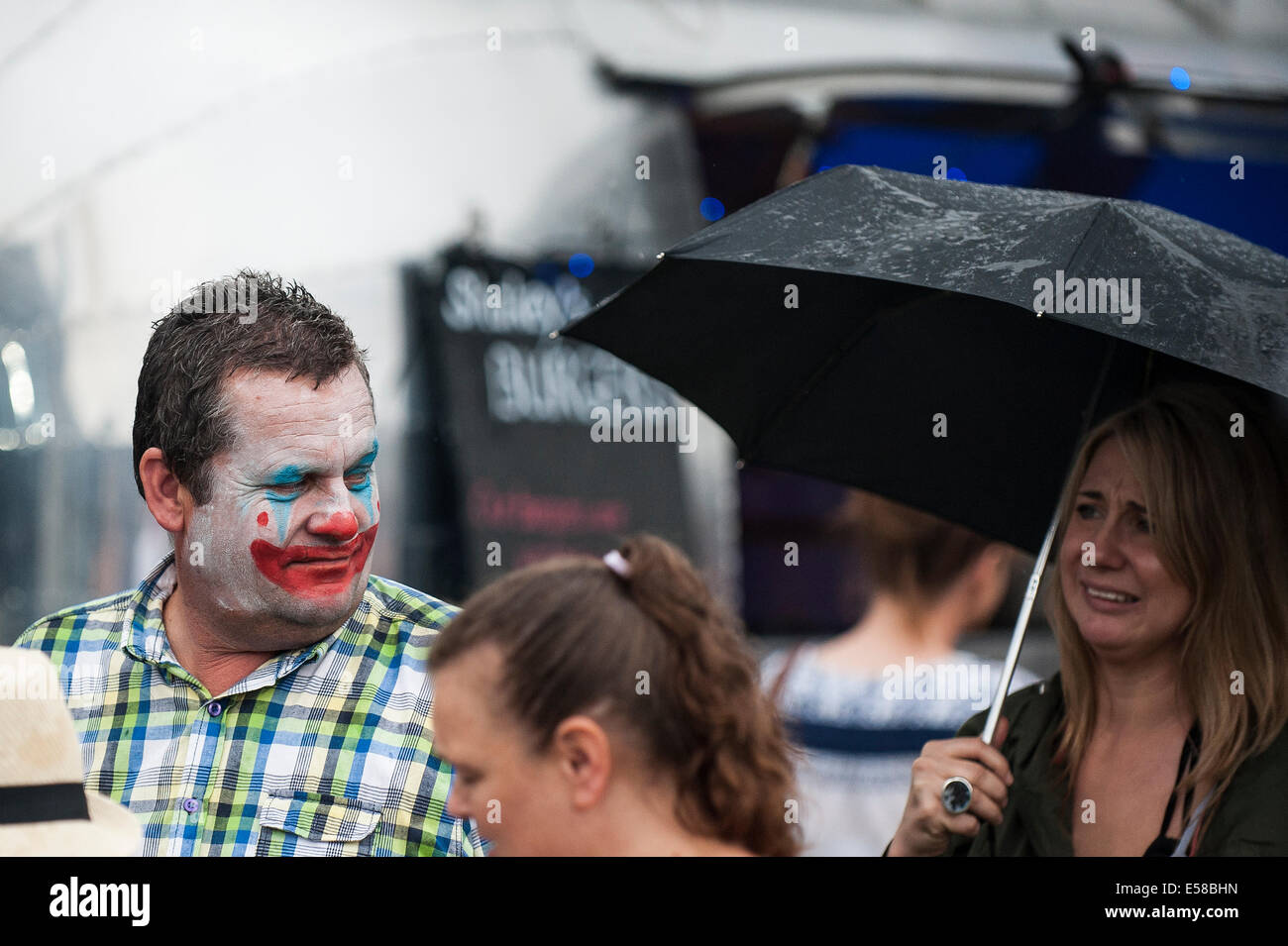 A man wearing clown makeup at the Brentwood Festival. - Stock Image