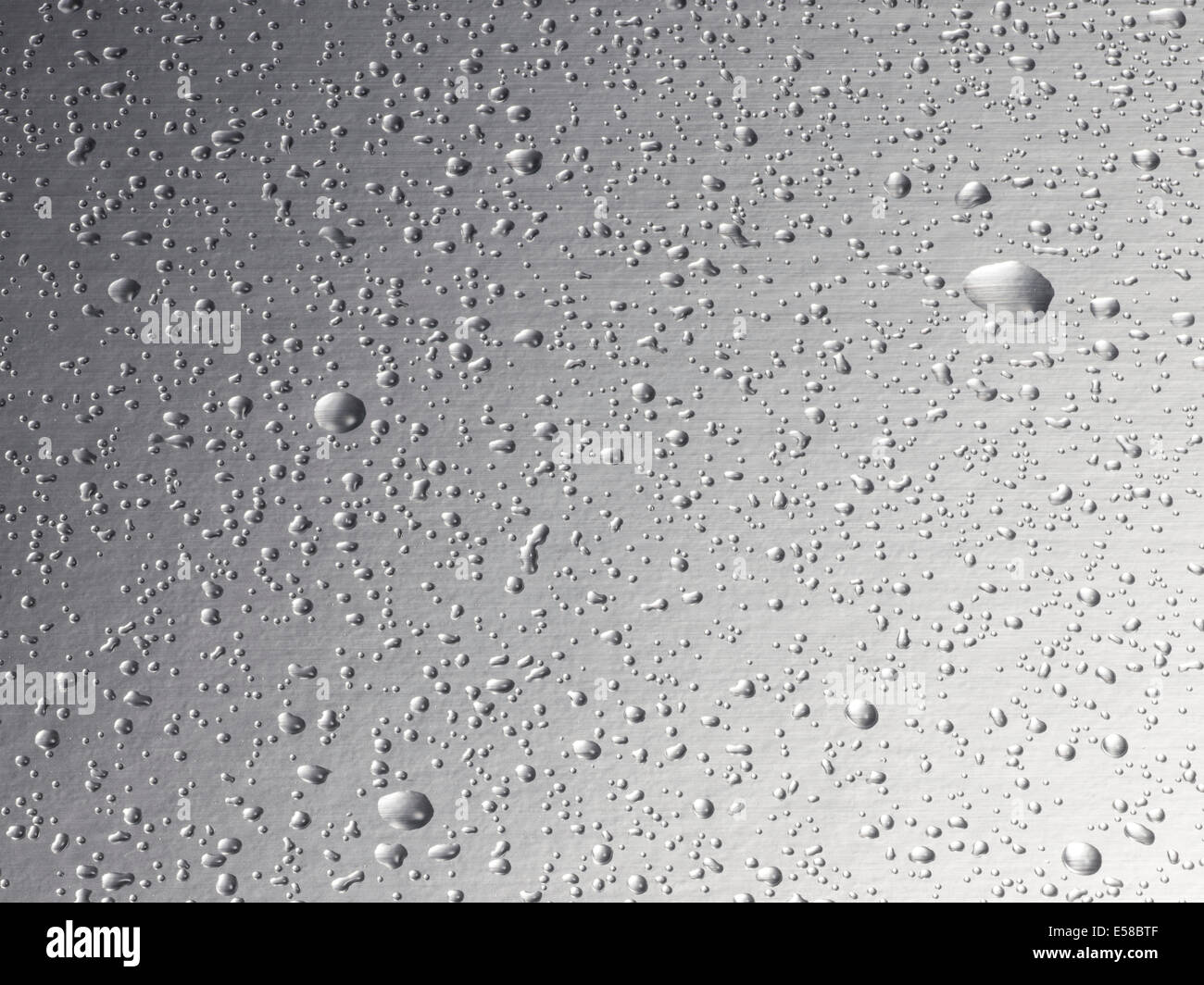 Water droplets on a steel background - Stock Image