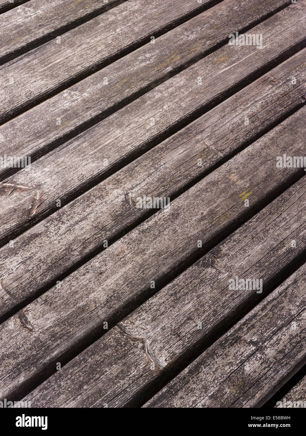 A weathered slated wooden background - Stock Image