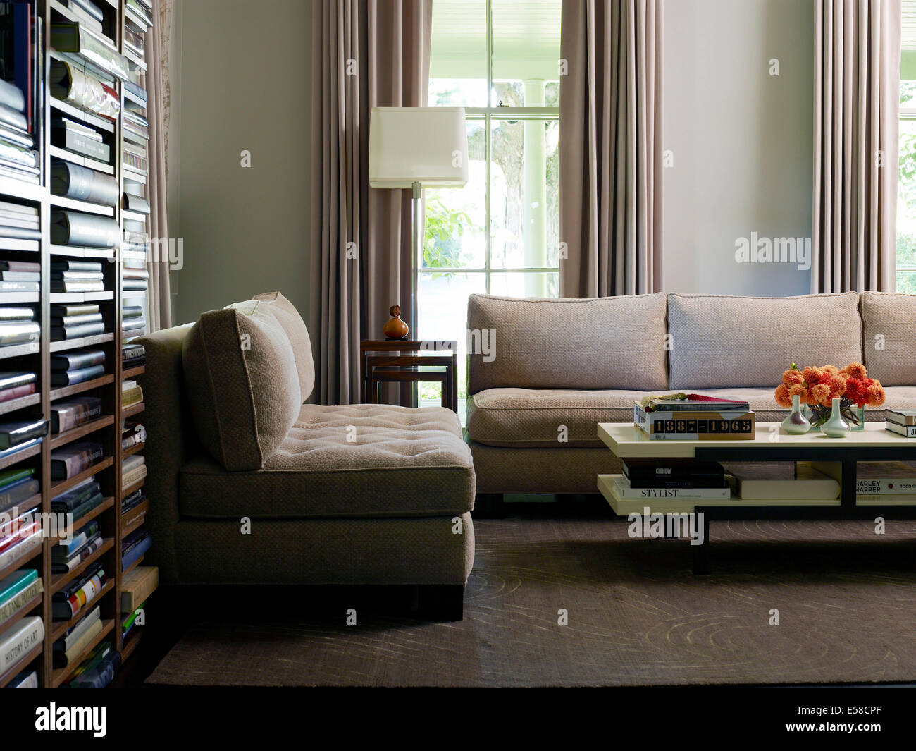 Book storage and coffee table in Jane Dillon-designed contemporary ...