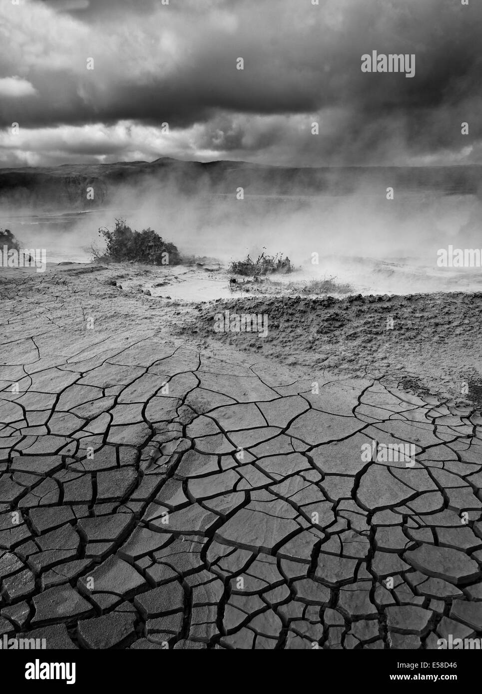 Cracked earth and mud pots, Geothermal hot spring area,  Hveragerdi, Iceland - Stock Image