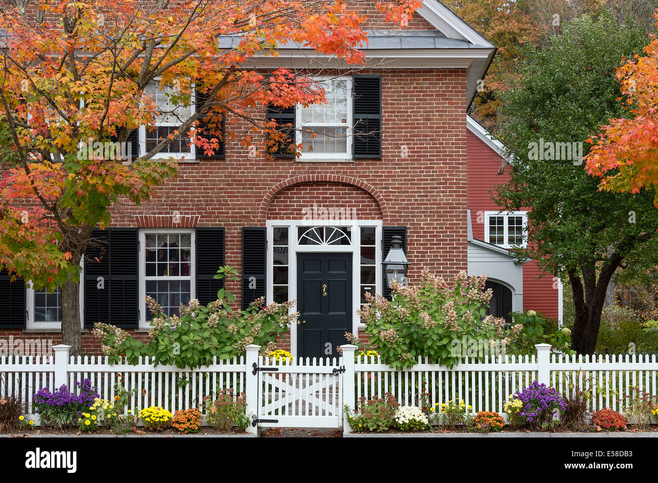 Charming New England brick house with picket fence, Grafton, Vermont, USA - Stock Image