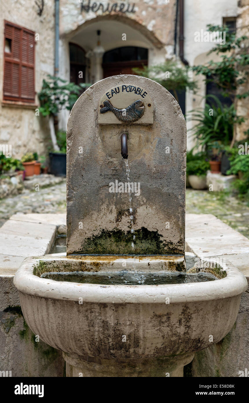 A rustic water fountain in a courtyard in the village of St Paul de Vence, Provence, France - Stock Image