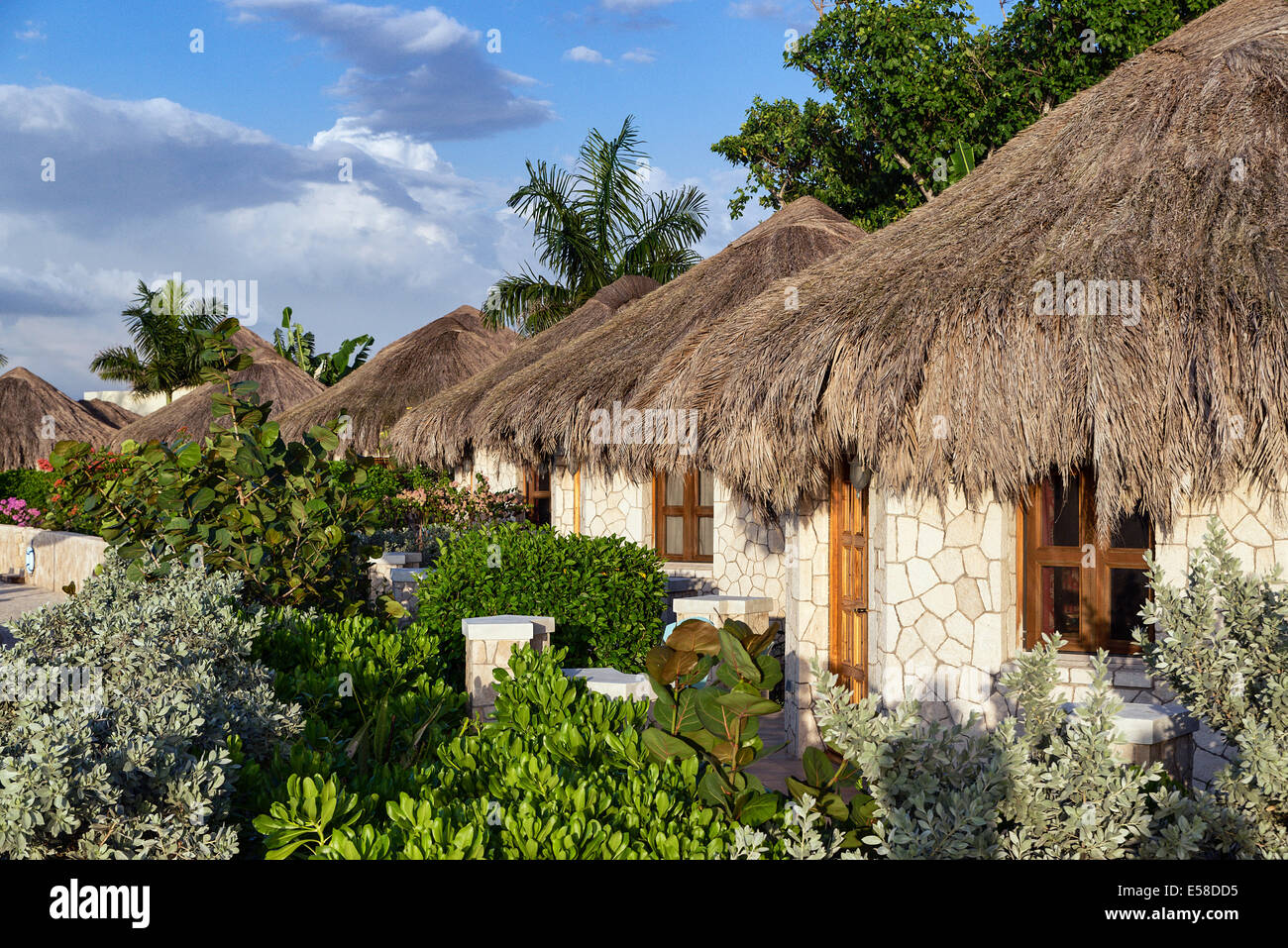 The Spa Retreat boutique hotel cottages with thatched roof. - Stock Image