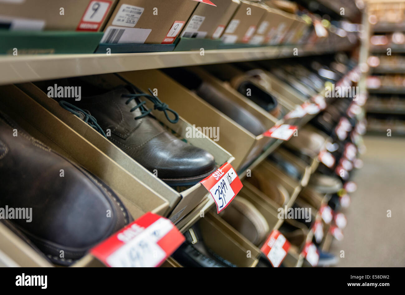 Men's shoes discounted in a store sale. - Stock Image
