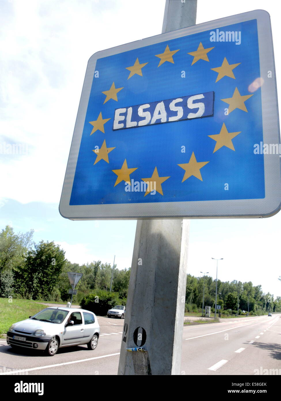 A car passes on July 18, 2014, the frontier between the german village of Sasbach (Baden-WÜrttemberg)and french - Stock Image