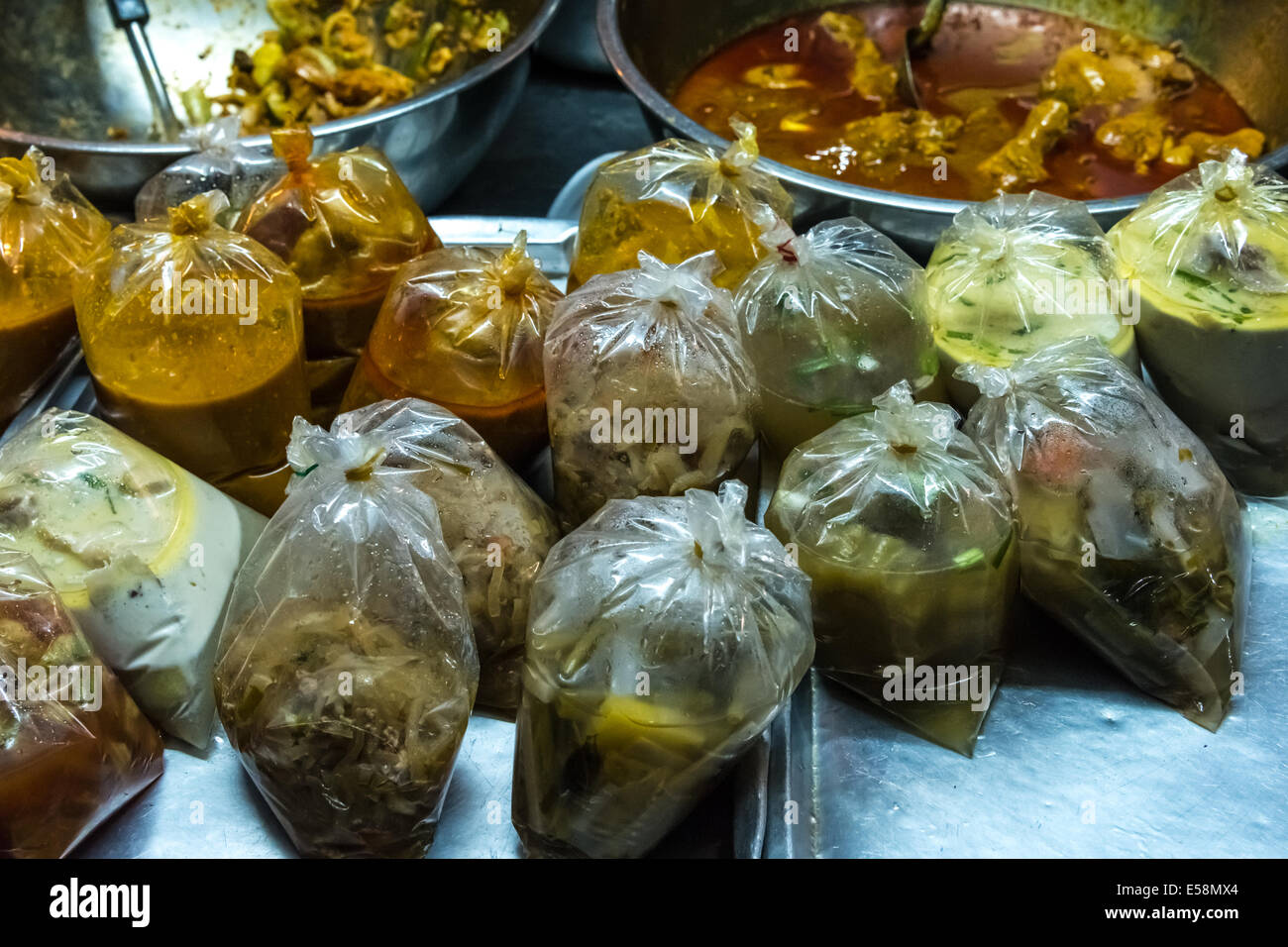 Thai soups for sale in the market. Thai food in plastic bag - Stock Image