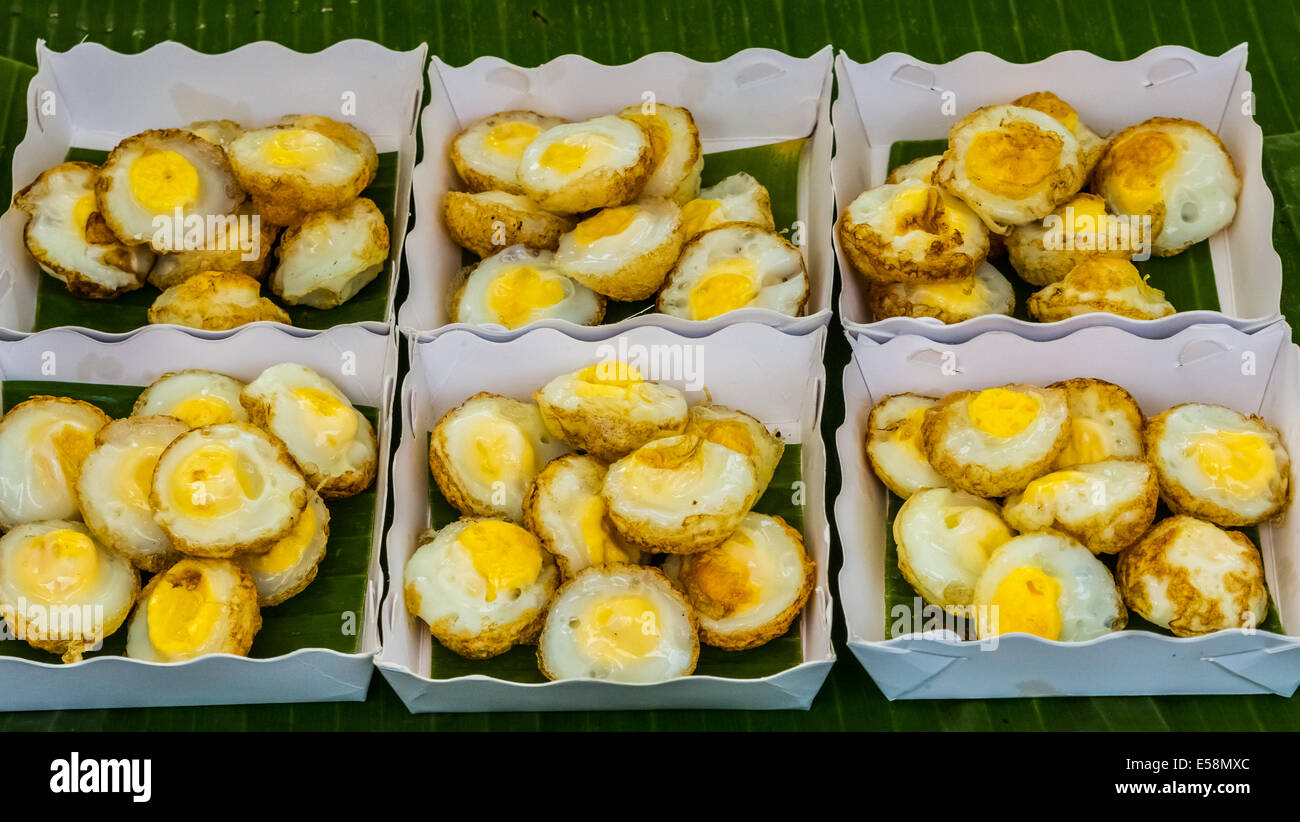 Fried quail eggs, thai food in a night market from Thailand Stock Photo