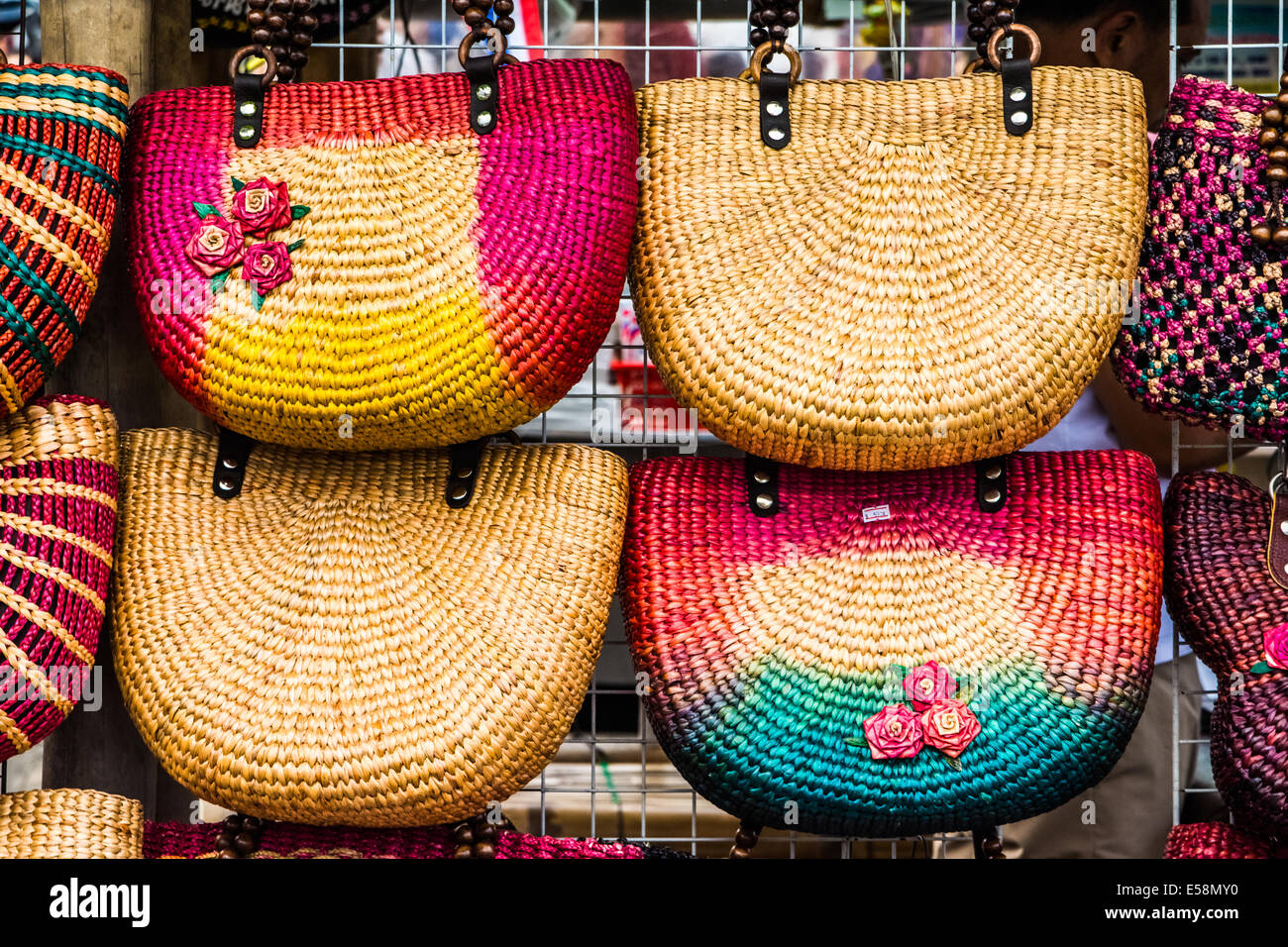 Colorfull handmade bags in a thai market. - Stock Image