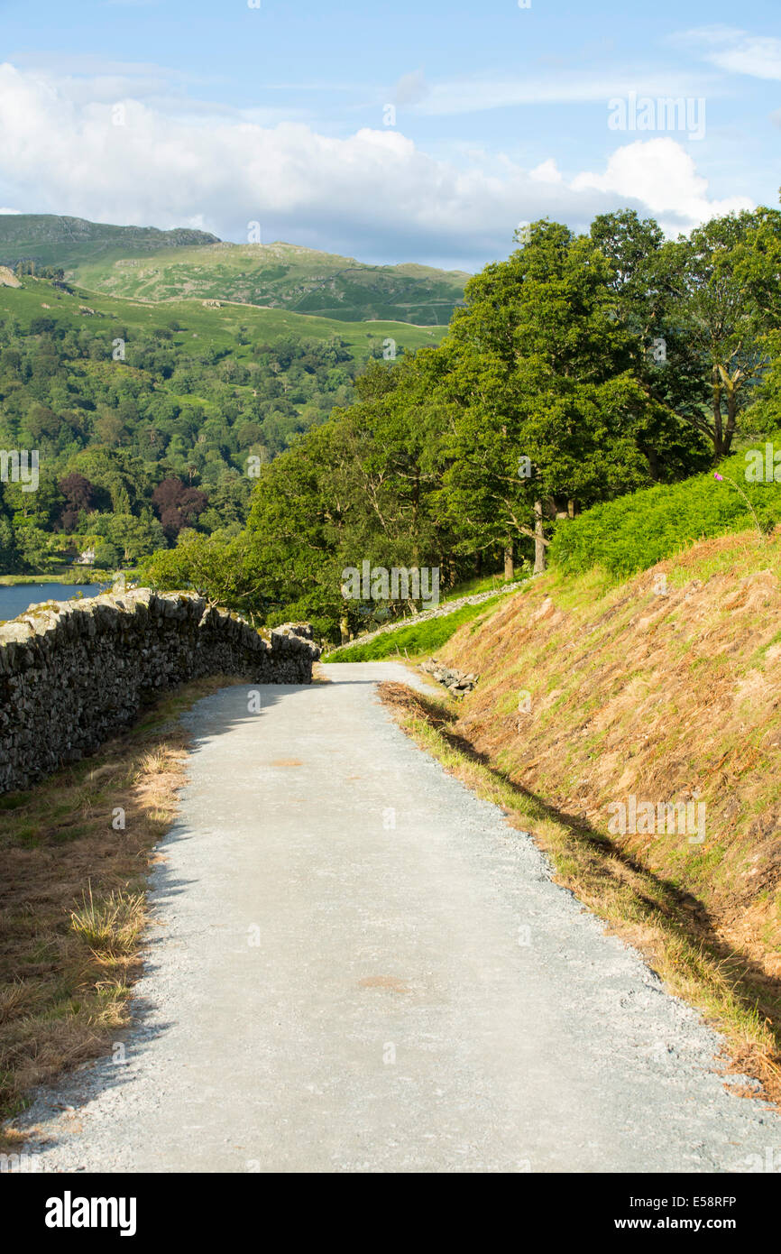 The shores of Rydal Water, Lake District, UK, where work is taking place to install a new bike path. - Stock Image