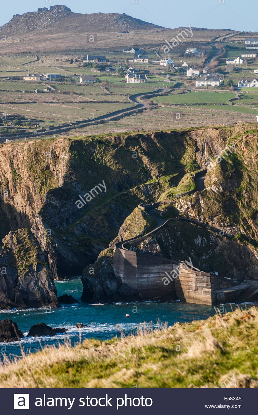 View of village and cliff with sea - Ireland - Stock Image