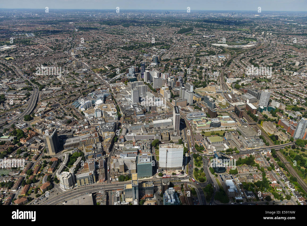 An aerial view of Croydon showing the town centre with the tall buildings of Central London visible in the distance. - Stock Image