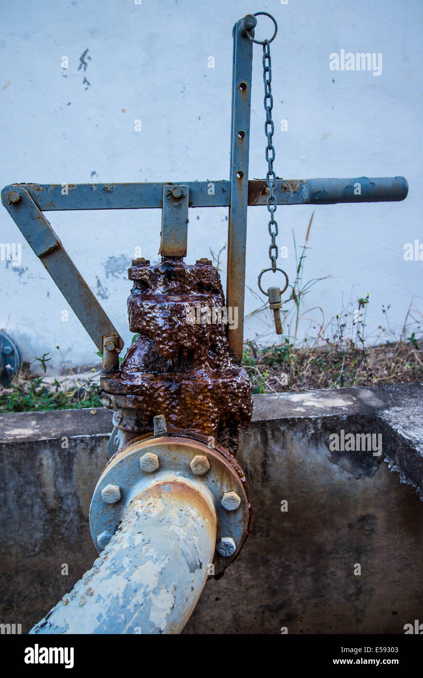 A rusty  water gate valve in the old industry factory. - Stock Image
