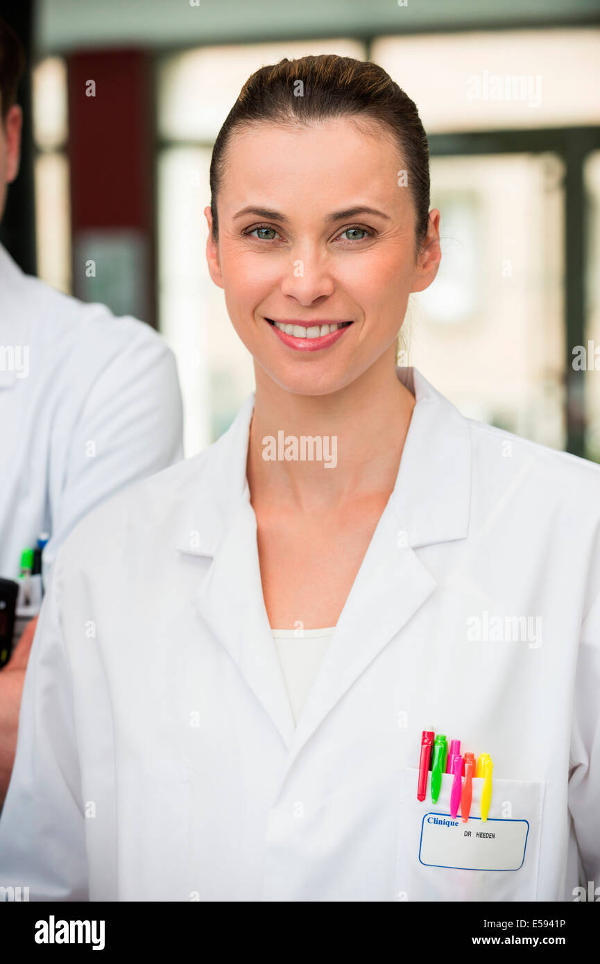 Portrait of a female doctor smiling - Stock Image