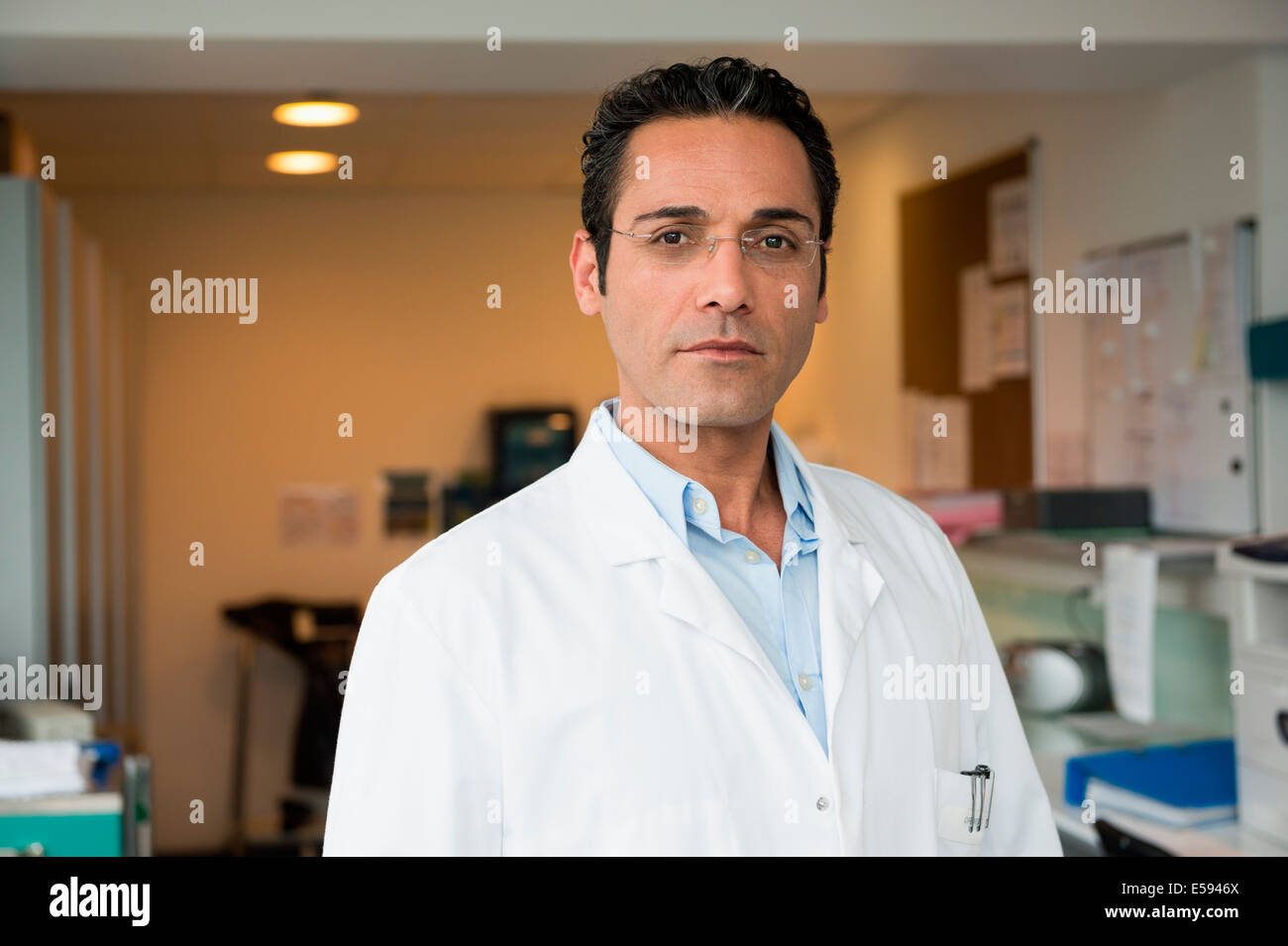 Portrait of a male doctor in hospital - Stock Image