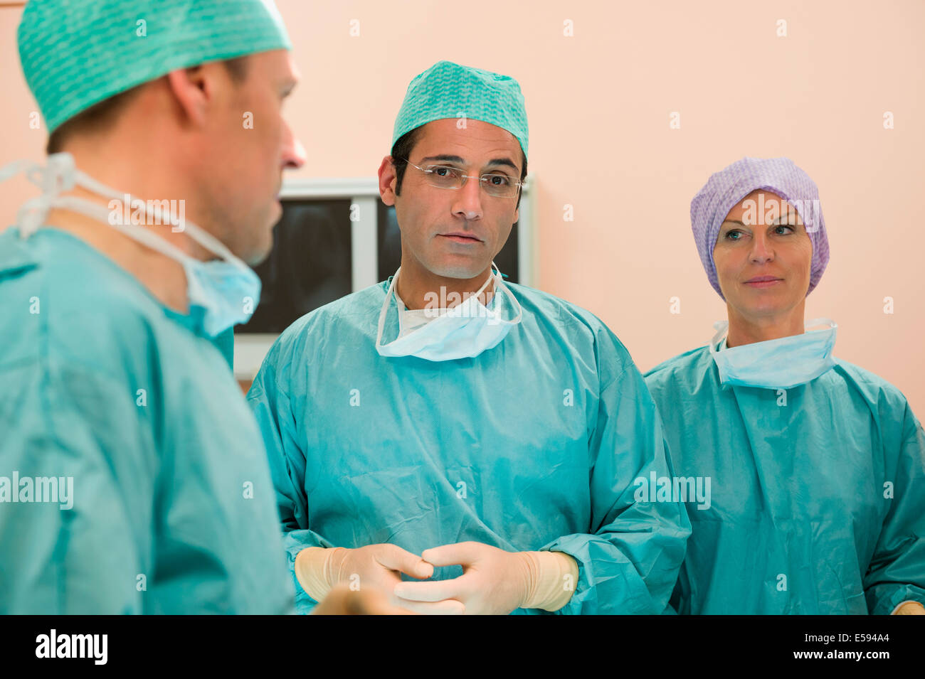 Surgeons in an operating room - Stock Image