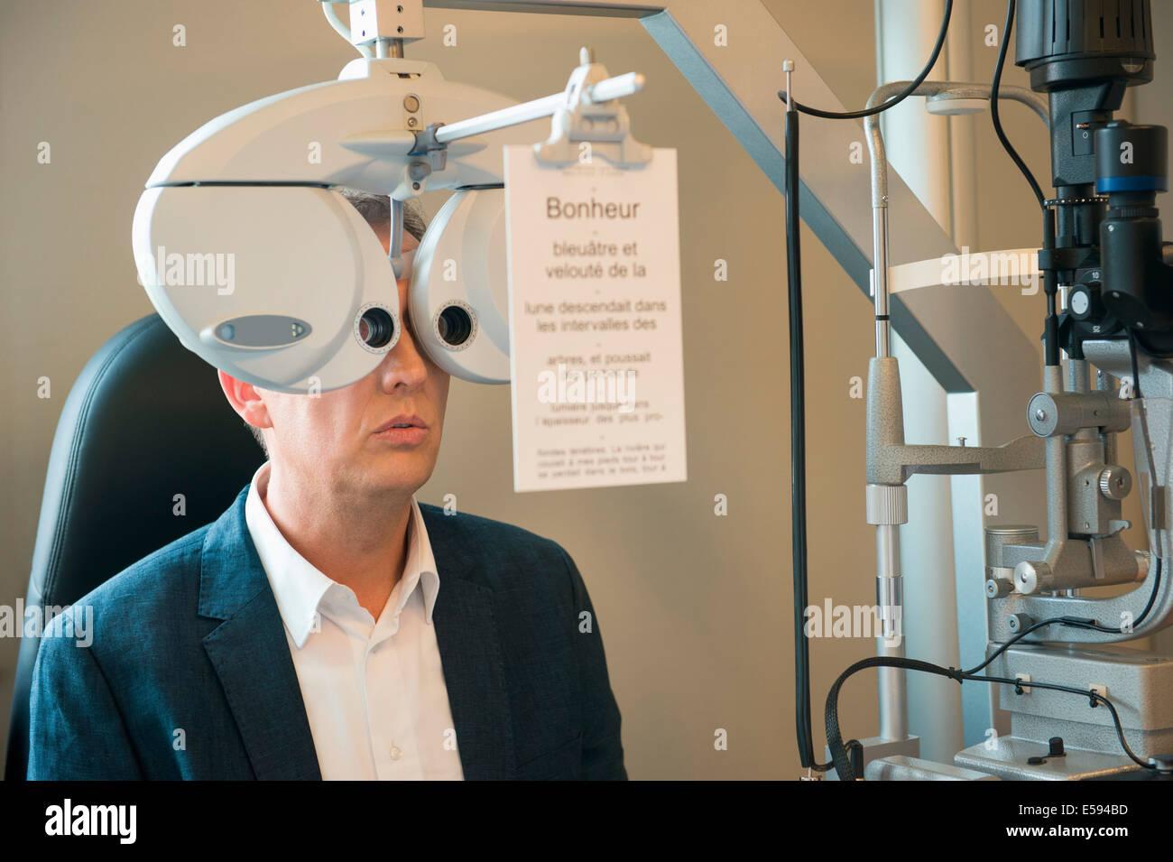 Male patient having eye examination - Stock Image