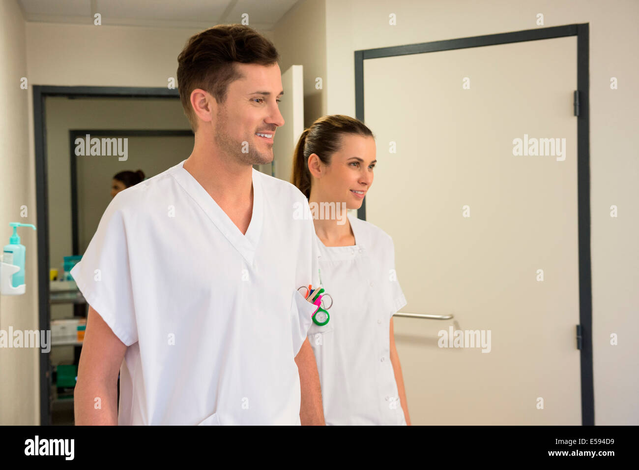 Doctor and nurse in a hospital corridor - Stock Image