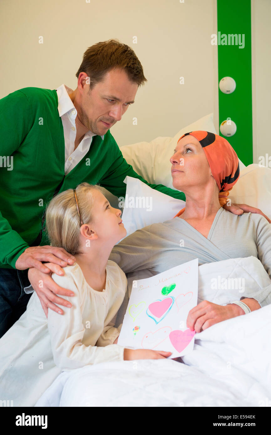 Girl with her father visiting to her mother in hospital - Stock Image