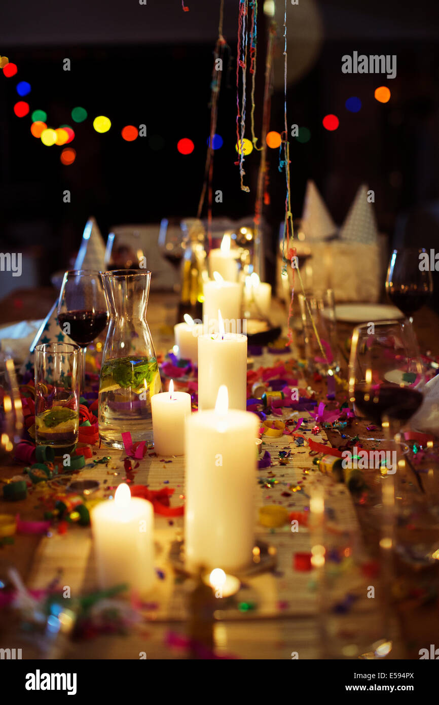 Lit candles on table at party Stock Photo