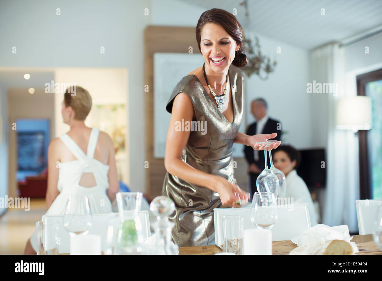 Woman setting table for party Stock Photo