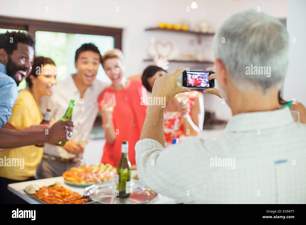 Friends taking picture together at party Stock Photo
