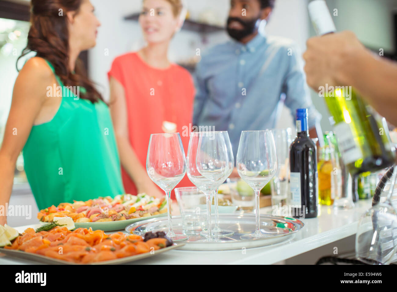 Food and wine on table at party - Stock Image